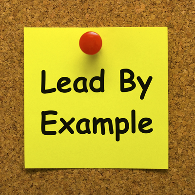 Lead by example text on a post-it