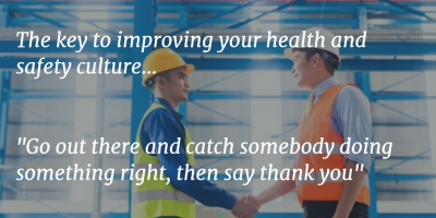 Image of two construction workers shaking hands