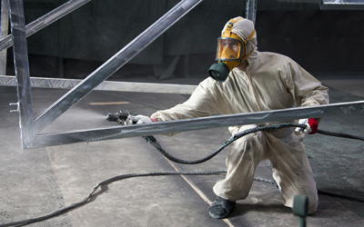 Spray painter wearing PPE